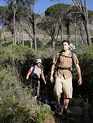 Two young men hiking in the forest
