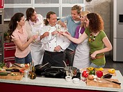 Chef toasting champagne with his students