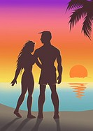 Silhouette of a couple standing on the beach