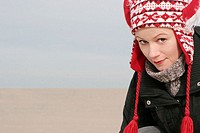Young beautiful smiling woman on a beach, winter