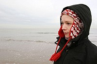 Young woman on a beach, winter