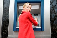 Woman using cash machine (thumbnail)