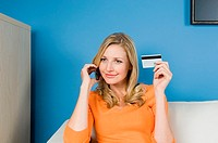 Woman using credit card and cell phone
