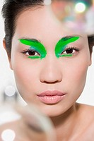 Woman with bright green eye shadow