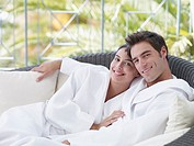 A couple relaxing in bathrobes