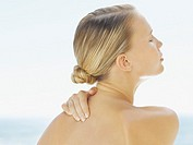 Woman looking serene with her hand behind her neck