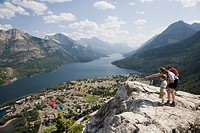 Mother and child enjoy view at Waterton Lakes National Park, Alberta Canada