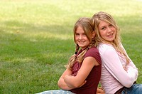 Portrait of young girls on grass, Regina, Saskatchewan