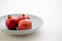 3 Pomegranates in low bowl