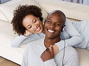 A couple with a man wearing headphones