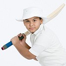 Portrait of a boy holding a cricket bat