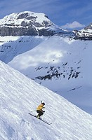 Young woman skiing in the bumps at Lake Louise Resort, Alberta, Canada