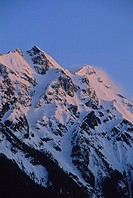 Mount Currie rises above Pemberton Valley, alpenglow lights snow, Pemberton, BC Canada