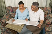 African American couple going over tile and carpet samples, Vancouver, BC