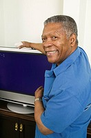 African American man with his new flat screen TV, Vancouver, BC