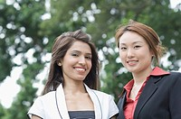 Portrait of two businesswomen smiling