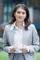 Portrait of a businesswoman holding a cup of tea