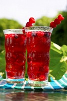 Two glasses of fruit juice garnished with raspberries, Canada, Ontario