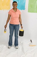 African American Woman Doing Home Improvement Painting, Canada, British Columbia