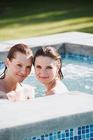 Lesbian couple relaxing in hot tub