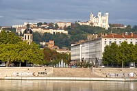 Buildings at riverbank with church on hill, Notre Dame De Fourviere, Rhone River, Lyon, Rhone_Alpes, France