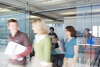 Office workers leaving conference room long exposure