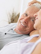 Couple embracing and smiling close-up (thumbnail)