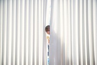 Girl 5-6 peeking from behind blinds (thumbnail)
