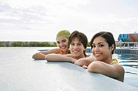 Three teenagers 16_17 in swimming pool portrait