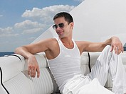 Young man relaxing on yacht