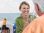 Middle_aged couple drinking champagne on yacht