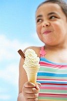 Girl 7_9 years holding icecream focus on icecream