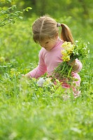 Girl picking flowers
