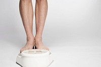 Man standing on weight scale