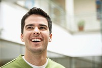 Man outdoors with happy expression