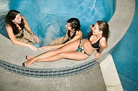 Young women relaxing in hot tub (thumbnail)