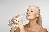 Woman drinking from a large bottle of water