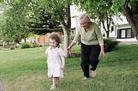 Grandmother chasing granddaughter