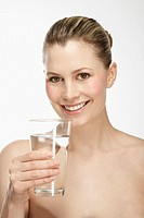 Smiling woman with a tall glass of water