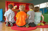 Young children watching a puppet show