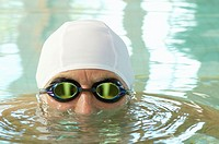 Senior swimmer with cap and goggles