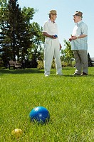 Two senior men playing bocce