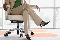 Businesswoman sitting in a chair (thumbnail)
