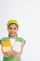 Girl holding paint samples (thumbnail)