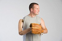 Man with prosthetic arm and baseball glove
