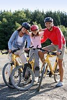 Parents and child on bikes