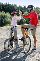 Father and daughter bike riding