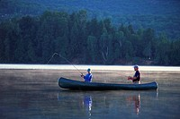Couple fishing from canoe