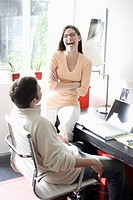 Woman laughing in home office