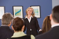 Businesswoman talking to a group